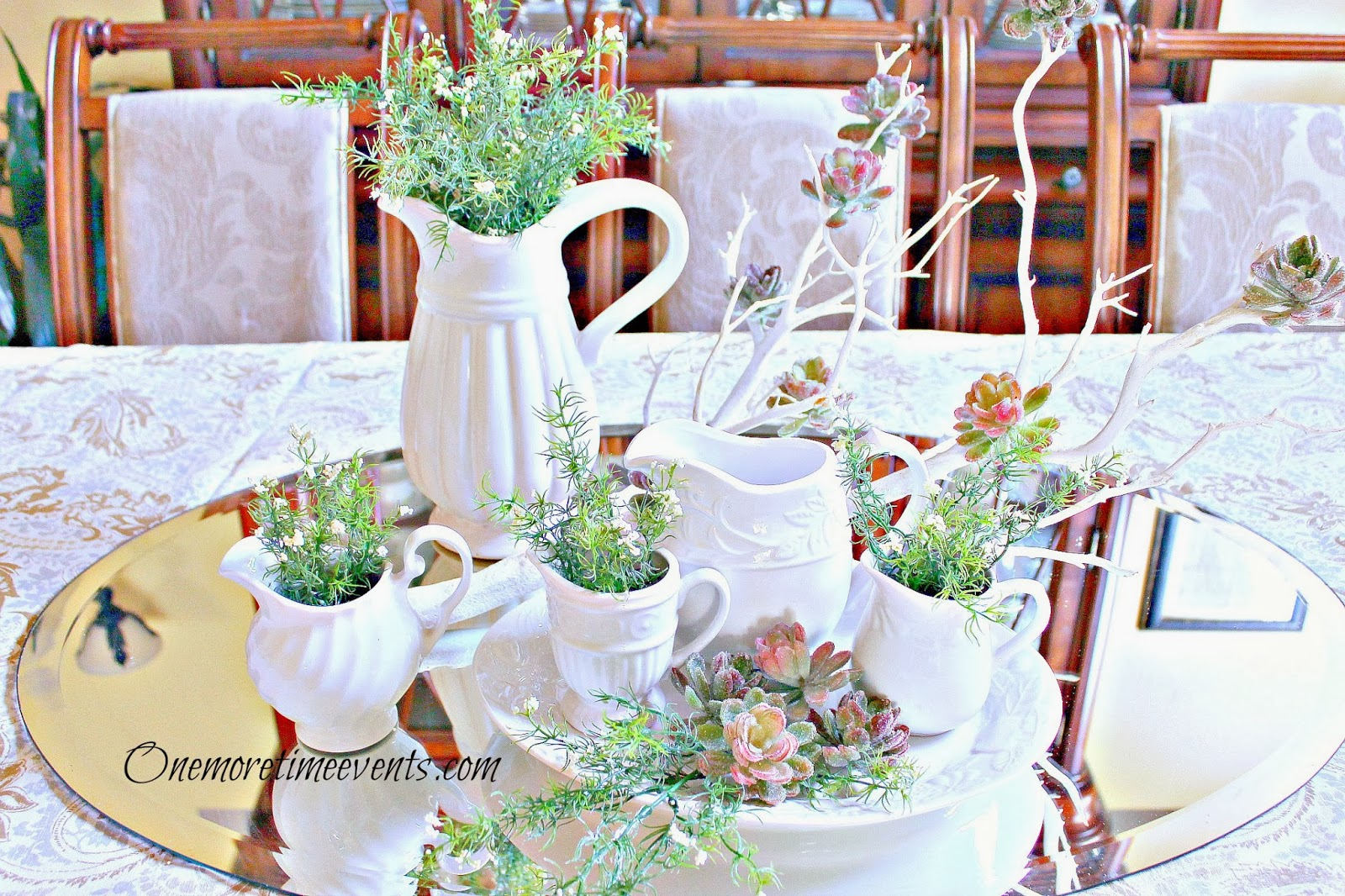 White Pitchers,greenery, succulent centerpiece at One More Time Events.com