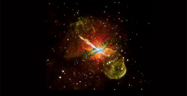 The Centaurus A galaxy, at a distance of about 12 million light years from Earth, contains a gargantuan jet blasting away from a central supermassive black hole. In this image, red, green and blue show low, medium and high-energy X-rays. Photo courtesy NASA/CXC/U. Birmingham/M. Burke et al.