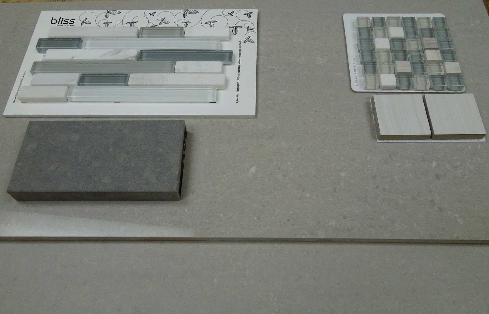 For The Master Bath   Gray Floor Tile With Matching Gray Tile For Shower,  White Cabinetry (not Pictured), Dark Gray Quartz Countertop With Narrow  Glass Tile ...