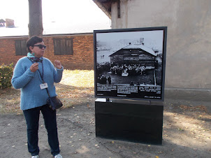 """Our tour Lady guide explaining us """"Auschwitz-I"""" concentration camp."""