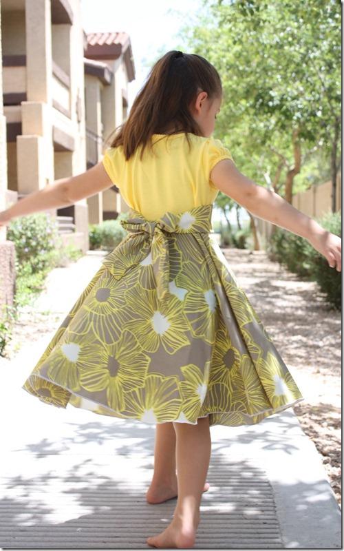 http://craftycupboard.net/twirly-t-shirt-dress-tutorial/