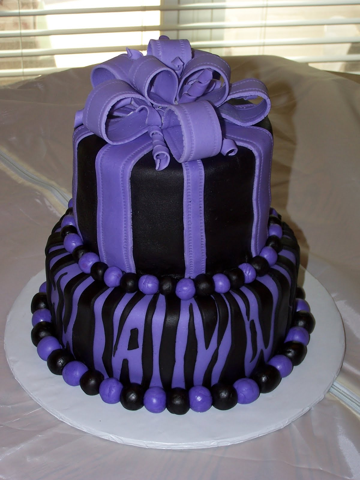 Two Layer Black And Purple Gothic Cakes