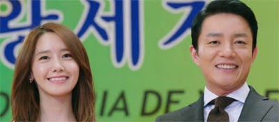 Im Yoon Ah as Nam Da Jung, and Lee Bum Soo as Kwon Yul, smile at an event.