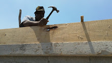 Cite Soleil, Haiti 2011: Local Mason helping the team build