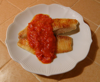 Golden Fish Topped with Bright Red Sauce