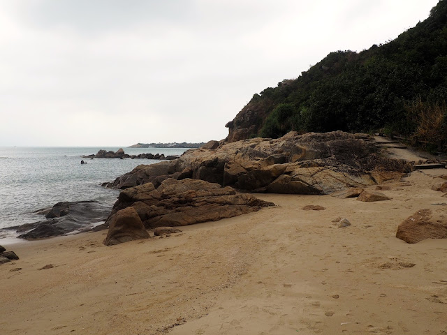 Rock formations by the sea at Hung Shing Yeh beach, Lamma Island, Hong Kong