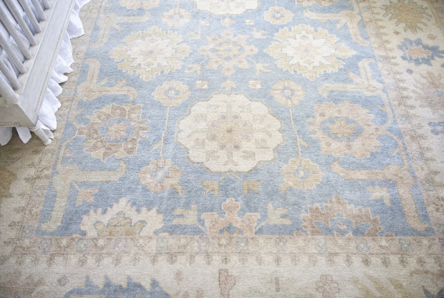 Blue and cream rug; Baby nursery; Nursery in the Nest; Nora's Nest