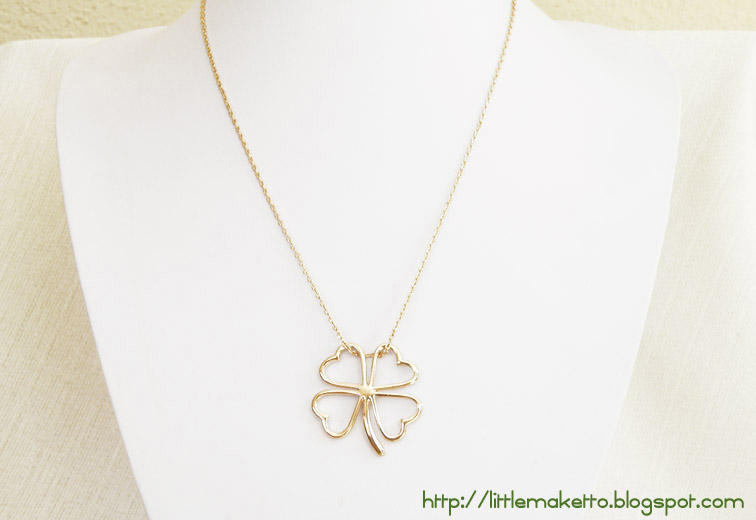 Golden shamrock necklace little maketto ne036 golden shamrock four leaf clover pendant outline in gold gold cable chain spring ring clasp length of chain 17 inches aloadofball Images