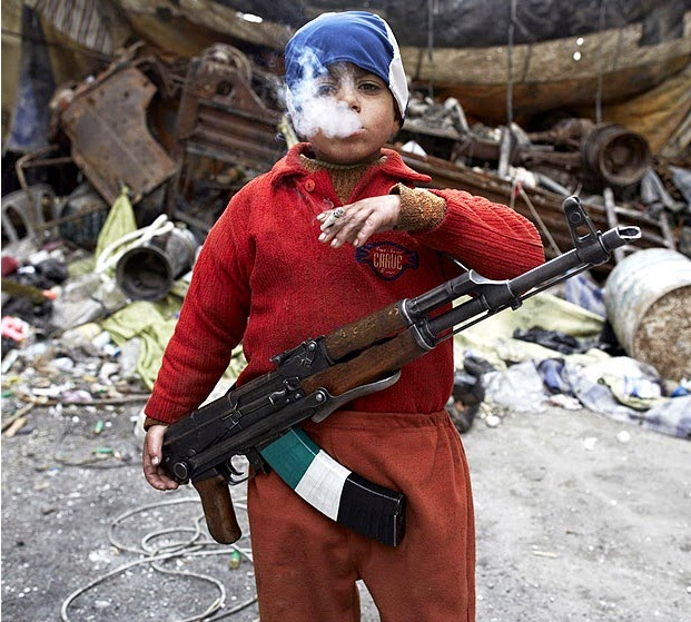 7 YEAR OLD SYRIAN REBEL - 29 Breathtaking Photographs of The Human Race