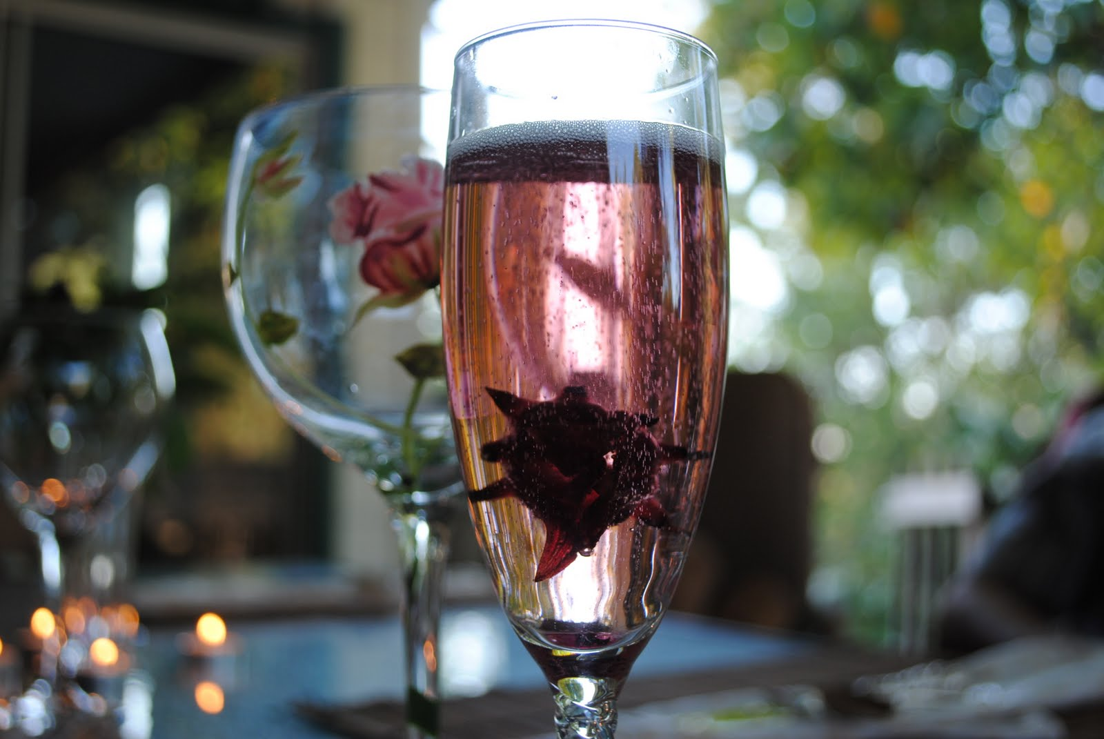 We started with a prosecco and wild hibiscus cocktail. Pop a flower in ...