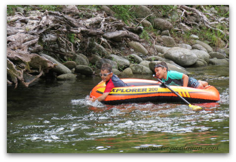 Riding the rapids in an inflatable boat