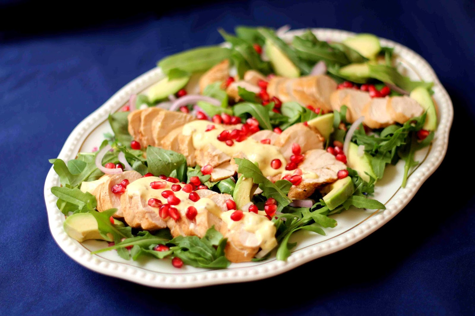Spoon over the dressing and sprinkle over pomegranate seeds.