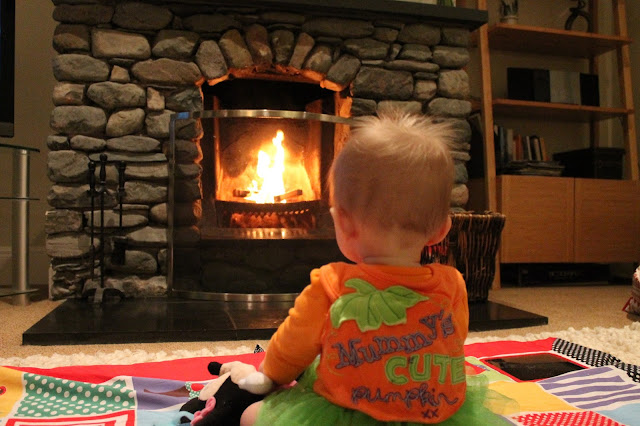 halloween photo baby staring at lit coal fire