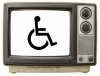 Photo of old style television set with the wheelchair on the screen