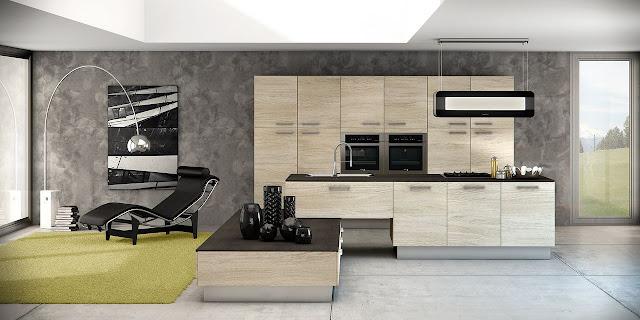 Cuisine design en bois avec îlot en L et mur d'armoires. Façades en bois clair avec beau veinage et plan de travail fin. Cuisiniste à Montpellier