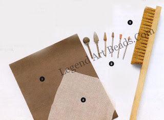 Texturing 1 Brass brush used with detergent; 2 burrs for use with the pendant motor; 3 graded wet and dry paper;  4muslin square for use with the rolling mill: