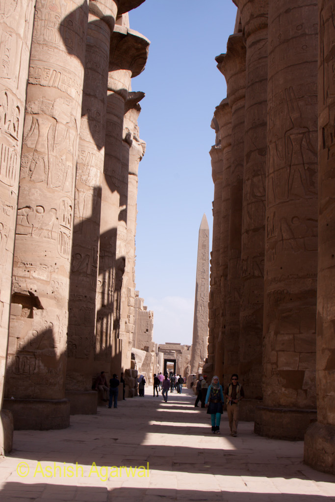 Narrow path between the pillars in the Hypostyle Hall inside the Karnak temple