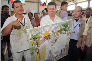 el presidente de Colombia Juan Manuel Santos y el pintor Marcos Unigarro