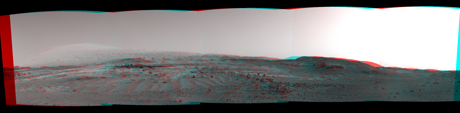 "NASA's Curiosity Mars rover used its Navigation Camera to capture this view on April 11, 2015, during passage through a valley called ""Artist's Drive"" on the route up Mount Sharp. The image appears three-dimensional when viewed through red-blue glasses with the red lens on the left. Image Credit: NASA/JPL-Caltech"