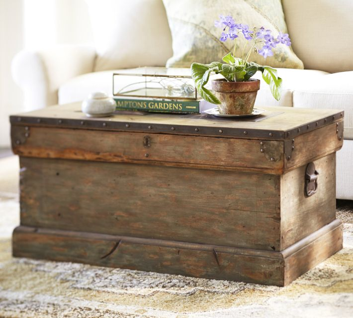 Stunning A distressed weathered trunk coffee table from Potterybarn can handle being used as a foot rest and snack table