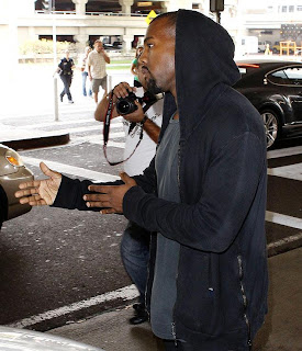 Photos ; Kanye West Charged With Battery For Fighting Photographer