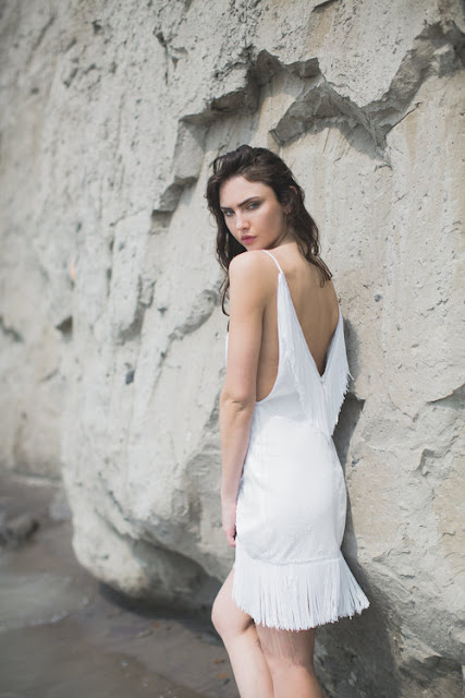 white fringe dress by And For Love