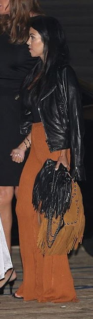 orange wide pants fringe bag Kourtney Kardashian street style