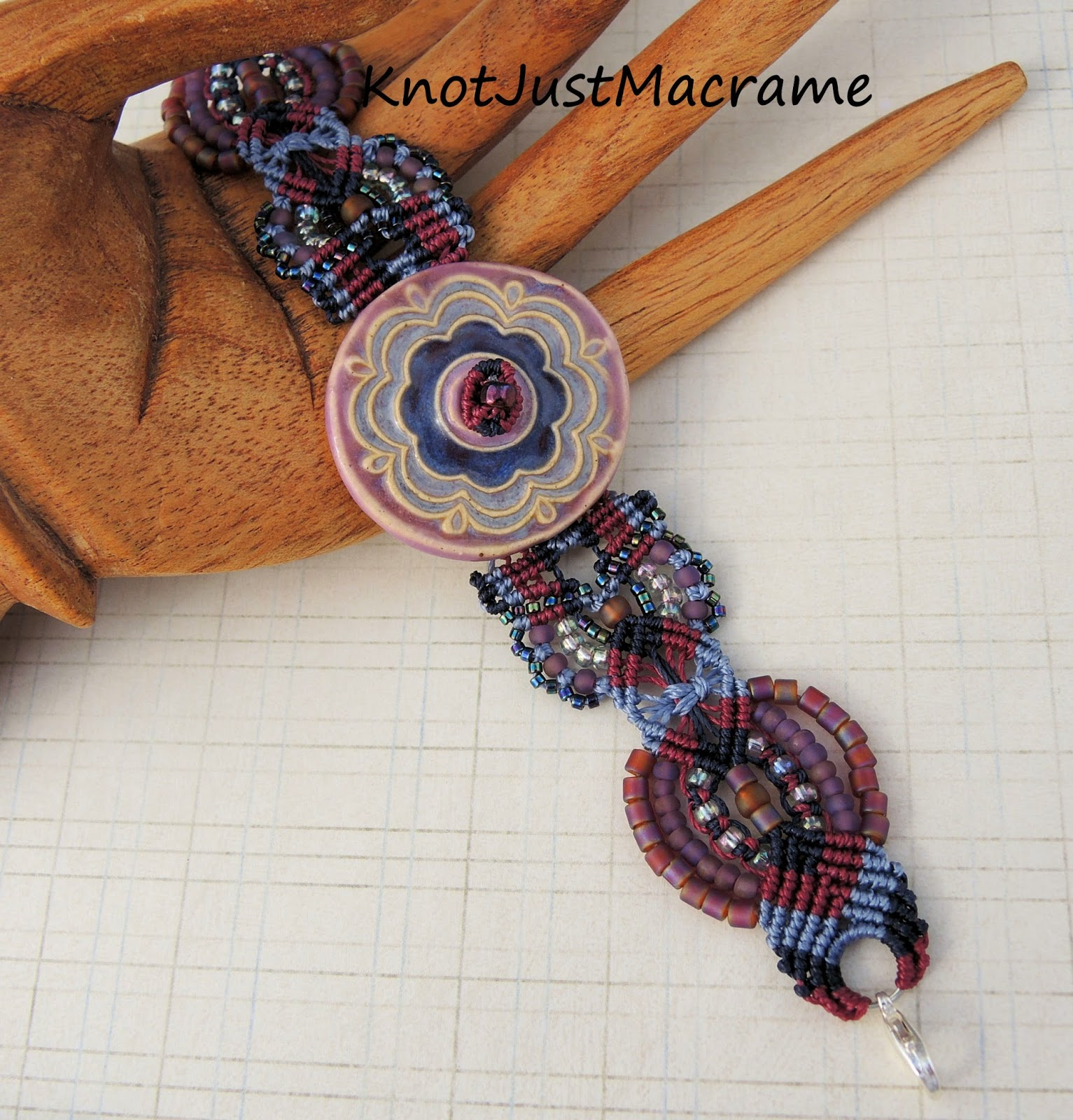 Macrame bracelet by Sherri Stokey with ceramic focal by Tracee Dock