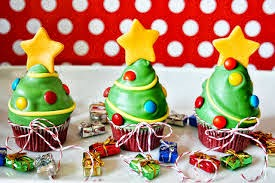 trio of Christmas Tree cupcakes with fondant and gold stars