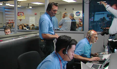 Curiosity MSL lands on Mars. Entry, Descent and Landing (EDL) team in blue shirts. Adam Stelzner, Lead of EDL waiting for news. Control room at JPL, 6 August 2012. NASA/JPL.