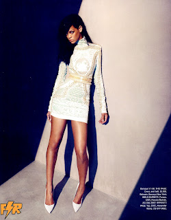 Rihanna leggy in a short white dress and heels