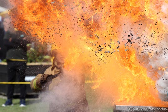 New Zealand Fire Service, demonstrating what happens when you use water to put out a stove fire, at the Bostock New Zealand Edible Garden Show, at Hawke's Bay Showgrounds, Hastings. photograph