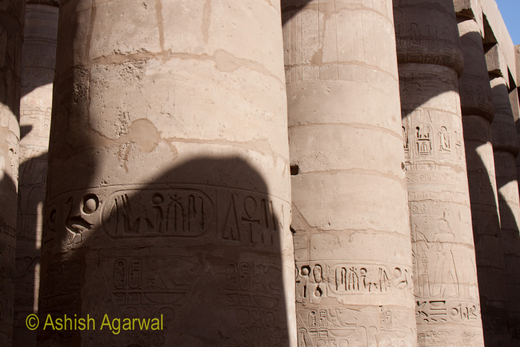 Shadows on pillar carvings inside the Hypostyle Hall in the Karnak temple in Luxor
