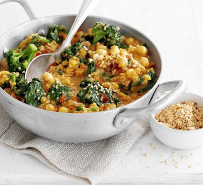 Picture of Chickpea, Tomatoes and Spinach Curry on metal bowl.
