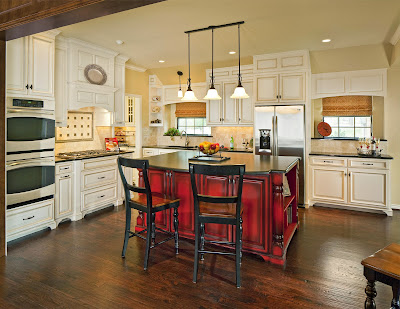 neutral hues in the kitchen cabinets and wall makes the red kitchen island eye-catchy and fascinating to see