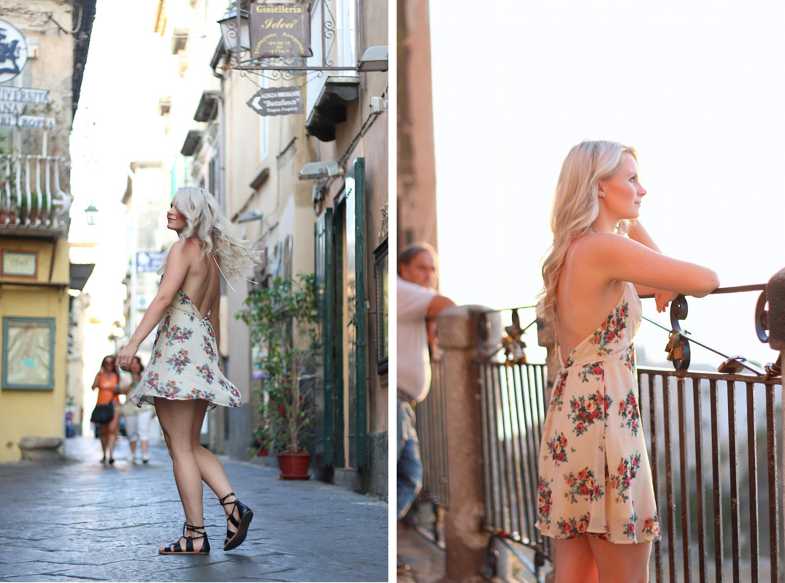 a blonde girl stands in front of purple flowers, wearing a floral dress in italy and twirls in the small streets