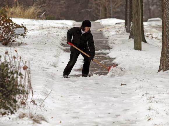 Shoveling snow (Credit: reuters.com) Click to Enlarge.