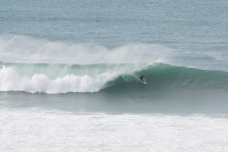 Surfing giant waves off newquay headland