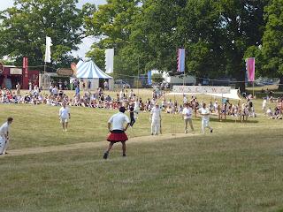 player in kilt at a cricket match british summer festival