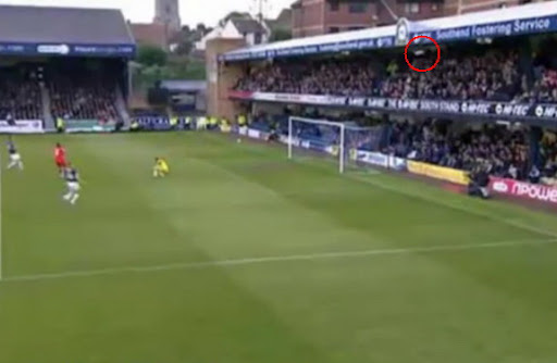 The ball kicked by Crewe's Byron Moore ends up in the stand behind the goal