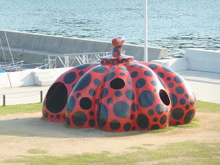 Another one of Naoshima's pumpkins, this one is larger, flatter and red with black spots. It's about as high as two people and has holes you can climb in. It's located in a grassy area near Miyanoura port