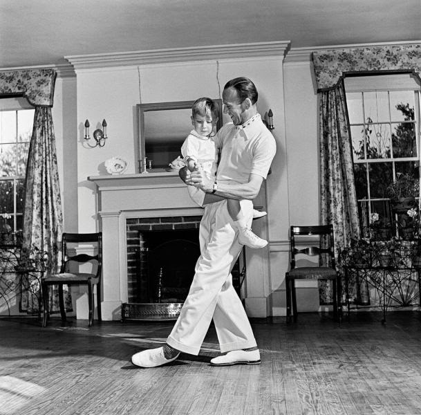 Fred Astaire dancing around the room.