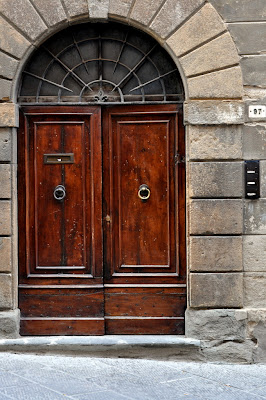 Wooden Doors in Montepulciano, Italy - Photo by Taste As You Go