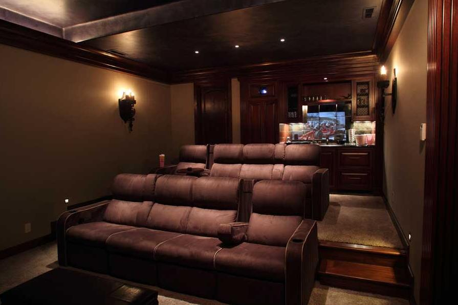 Elegant Home Theater Room Design With Brown Sofa Color And Wall Lighting Lamps For