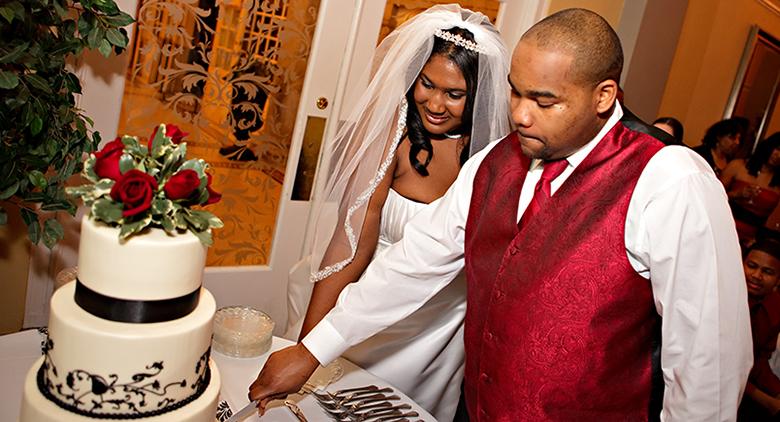 Pitts Wedding happy couple cutting cake