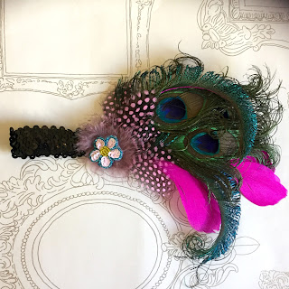 http://talulahblue-talulahblue.blogspot.co.uk/2015/11/fancy-peacock-fascinators.html