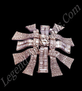 A ribbon weave brooch, consisting of six interwoven pave diamond ribbons with two half-moon diamonds in the center, made for Ma Negri, c.1947.