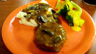 Comfort Food: Mashed potatoes and gravy, steamed broccoli in cheese sauce and ground beef steak.