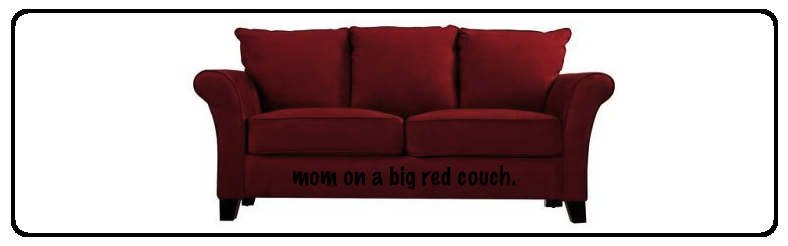 mom on a big red couch