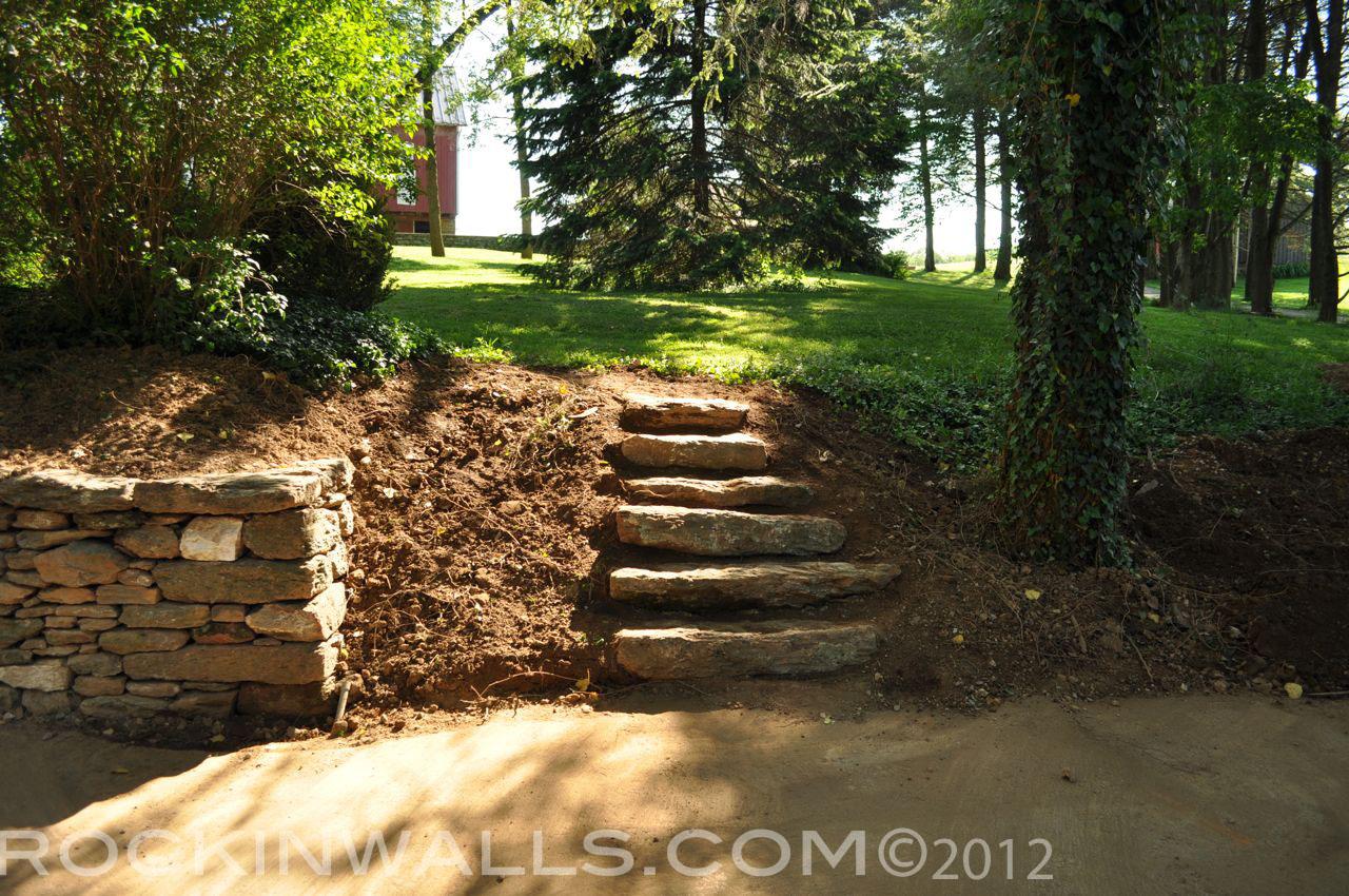 http://2.bp.blogspot.com/-ta-ivsFPTUw/T9u9p61NfWI/AAAAAAAACJI/gvMZcd2sm2k/s1600/WM+27b+Steps+6+Glenville+Dry+Laid+Stone+Retaining+Wall.jpg
